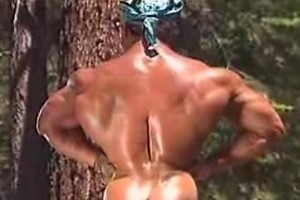 Big muscled gay working in the woods showing his hot body
